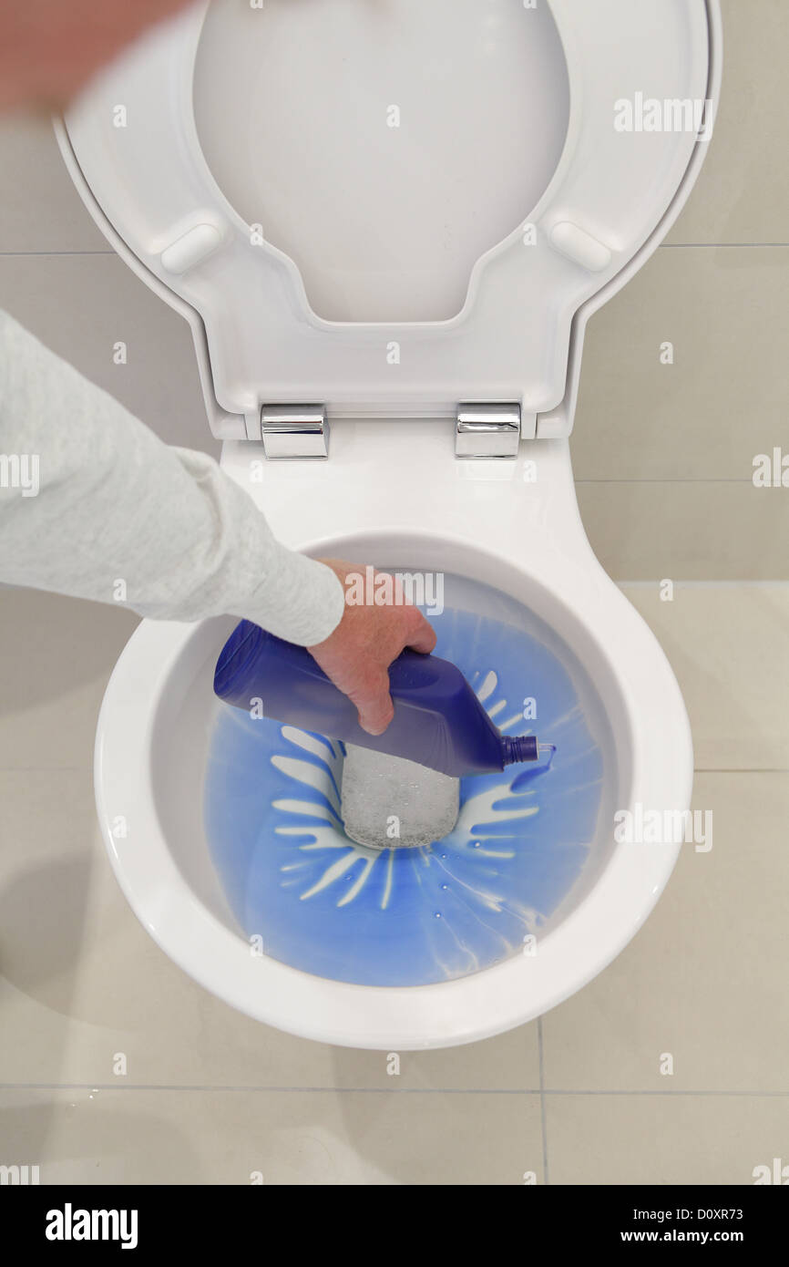 Pouring disinfectant into toilet - Stock Image