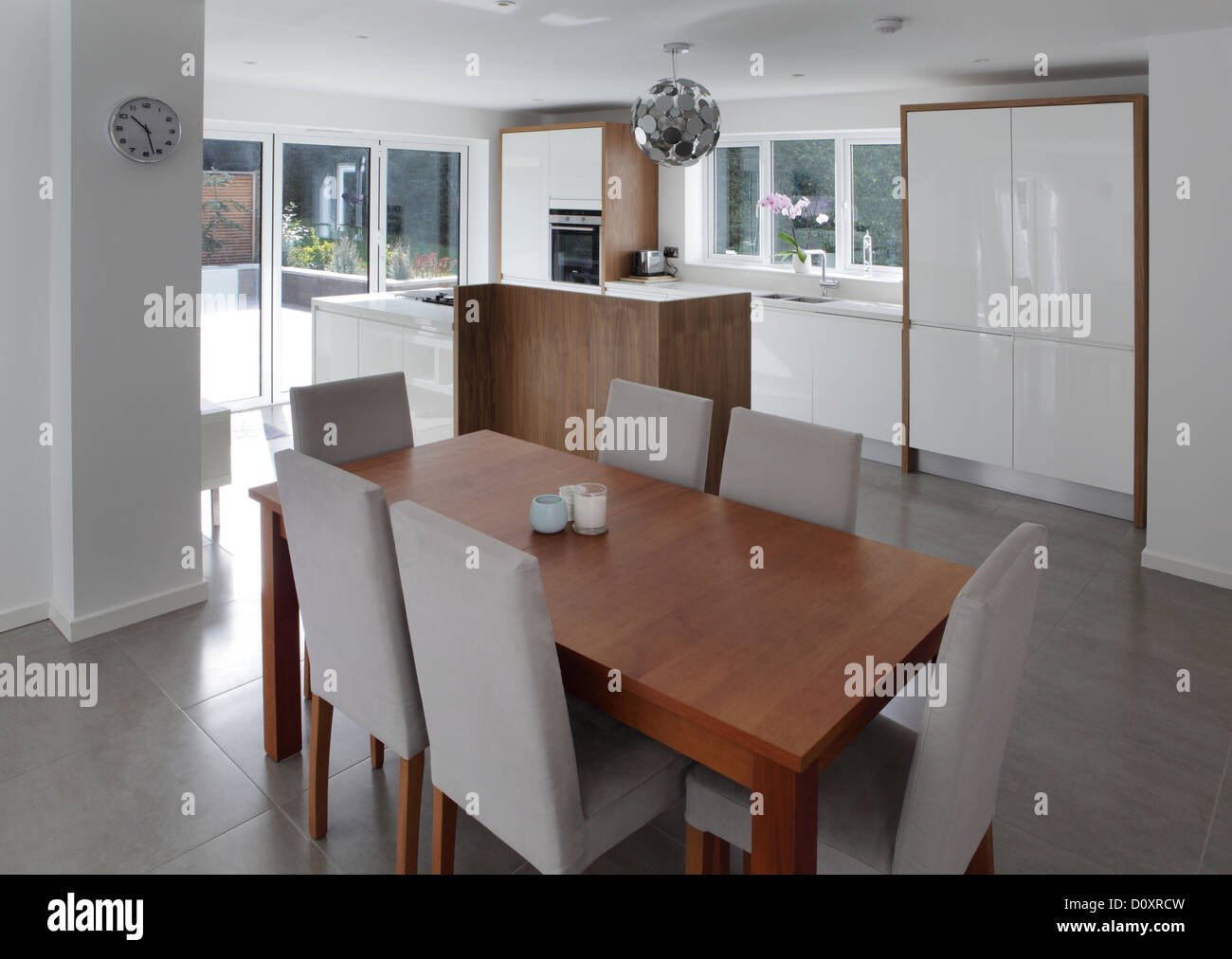 Dining table in open plan house - Stock Image