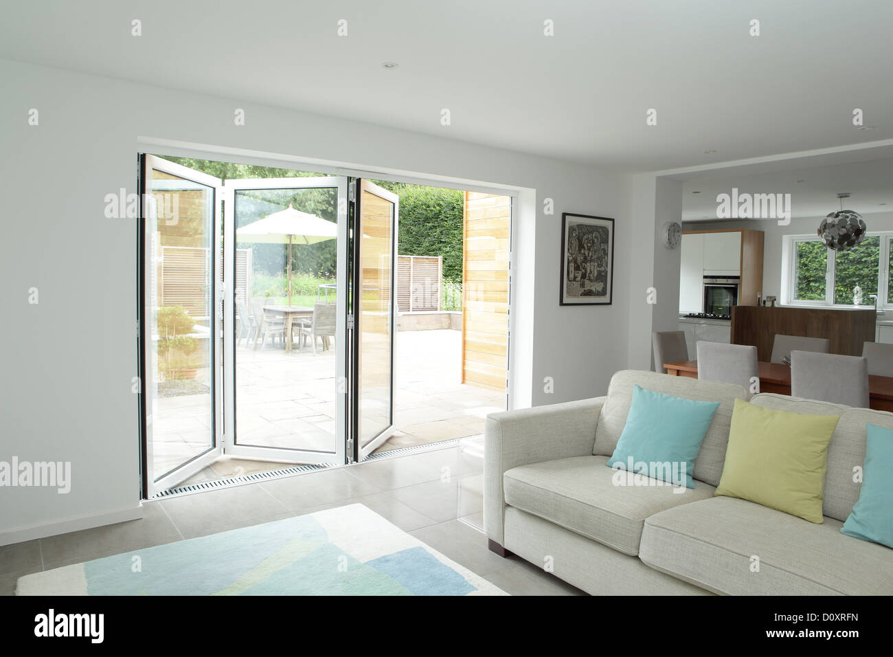 Open plan living area with open patio doors Stock Photo