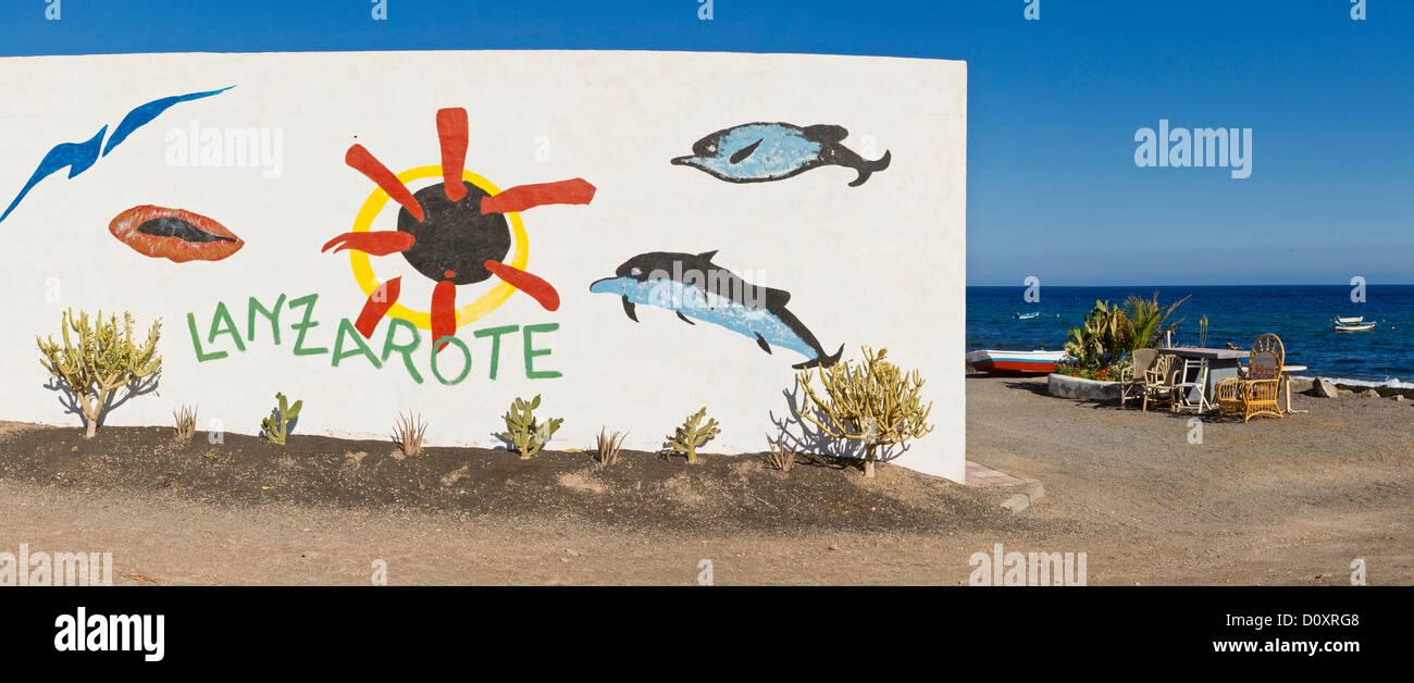 Spain, Lanzarote, Playa Quemada, Promotional, graffiti, house, water, summer, sea, Canary Islands, - Stock Image