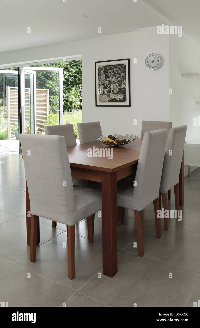 Table and chairs in dining area - Stock Image