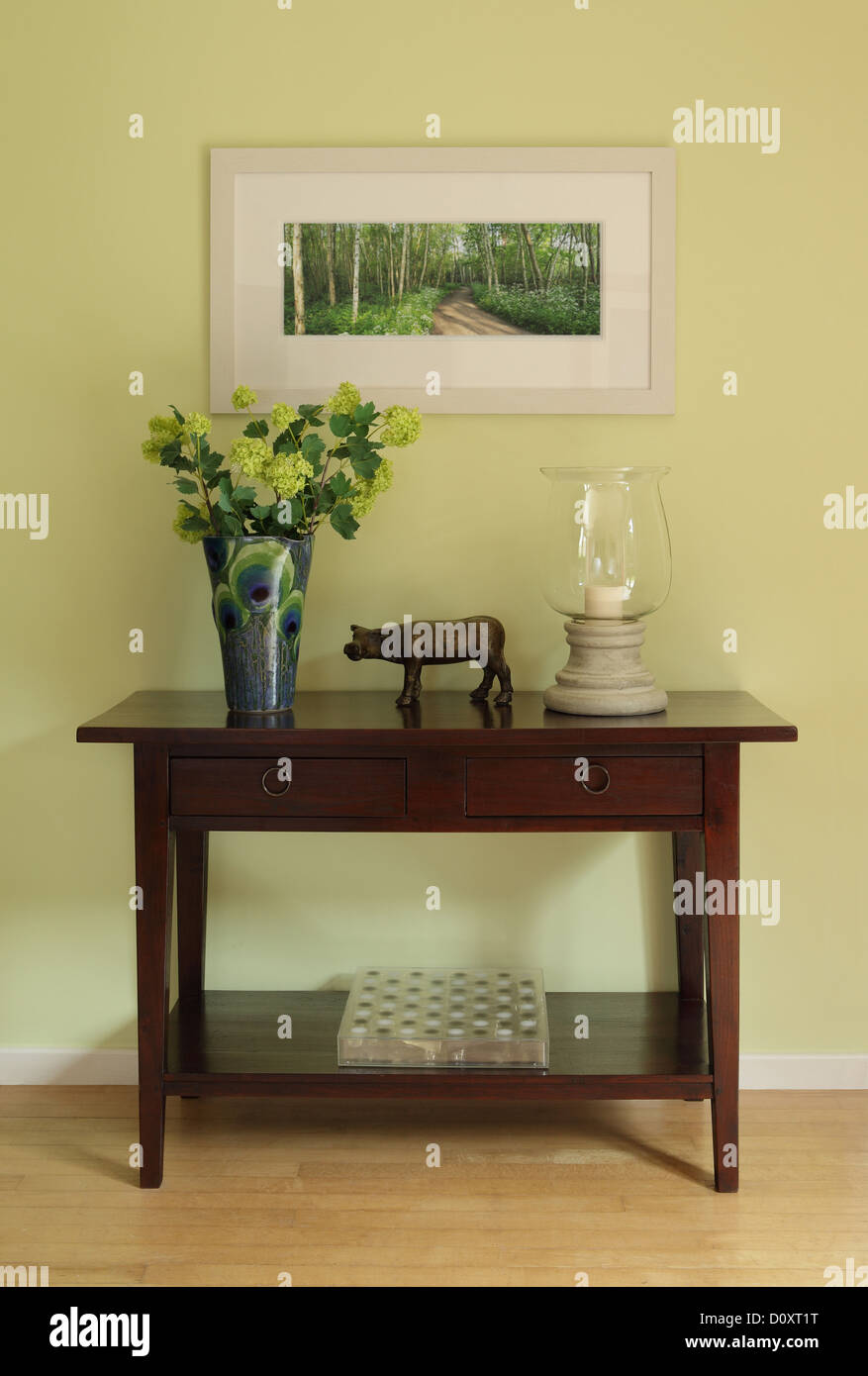 Sideboard with ornaments and vase - Stock Image
