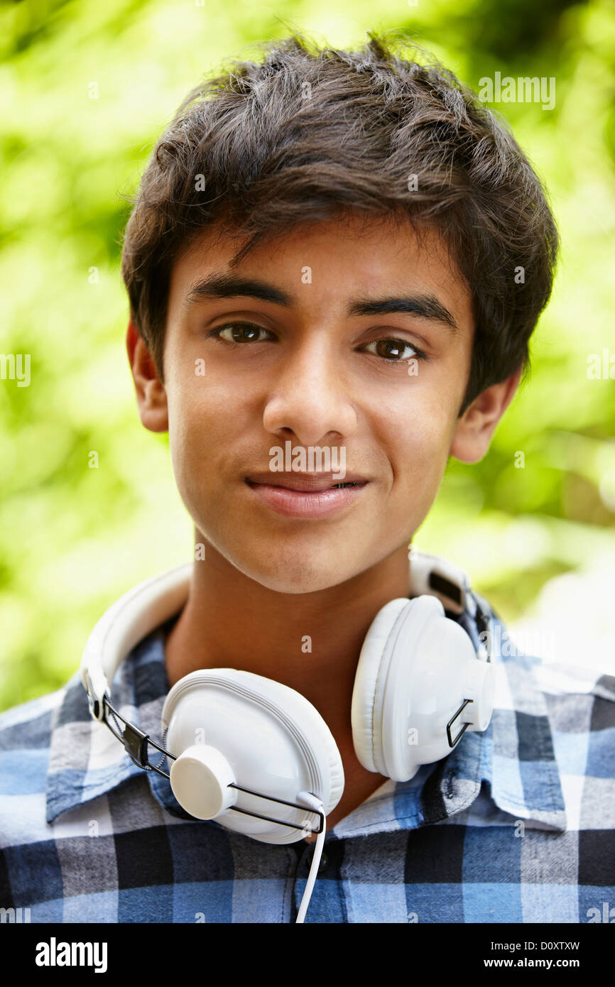 Portrait of teenage boy with headphones - Stock Image