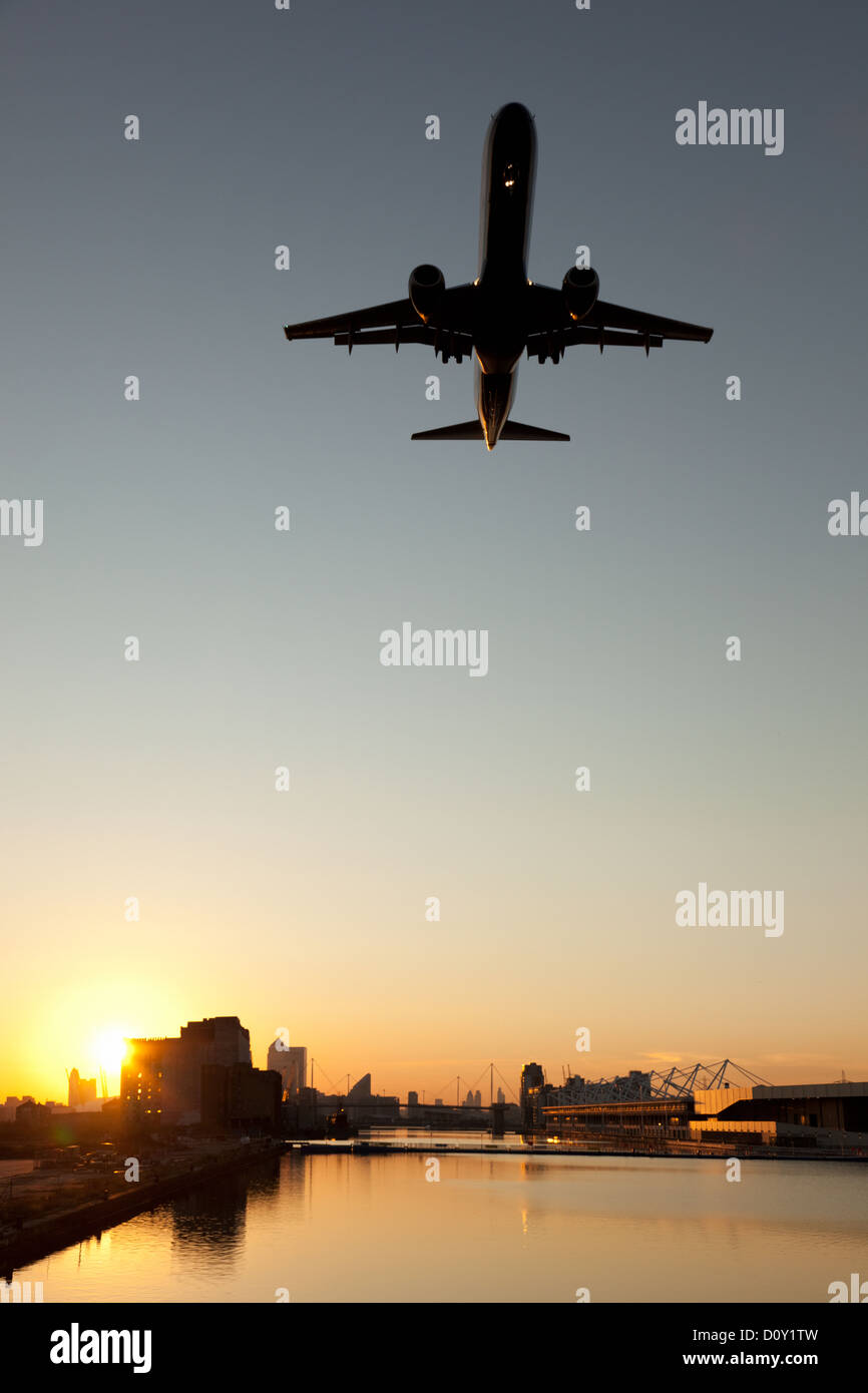 an airplane on its final approach to London City Airport - Stock Image