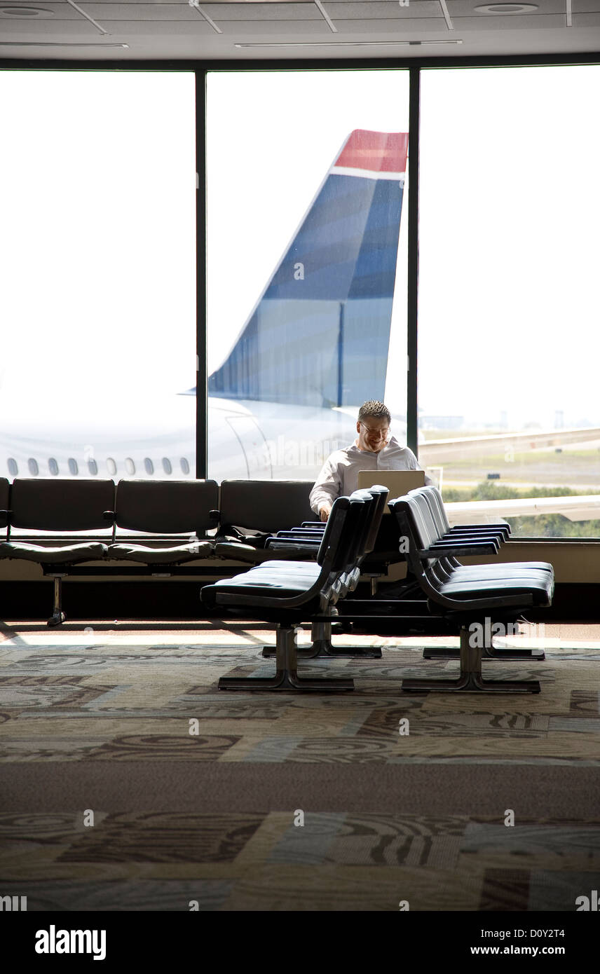Business Man In Airport Waiting Area Gate, Philadelphia, USA - Stock Image