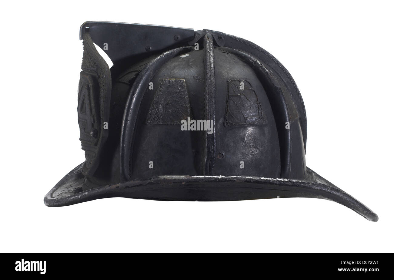 Blackened & Burned Fireman Helmet - Stock Image