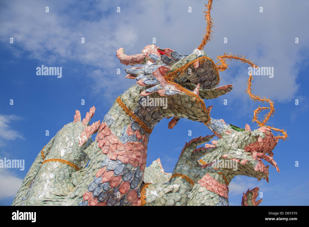 origami dragon from a money of thailand - Stock Image