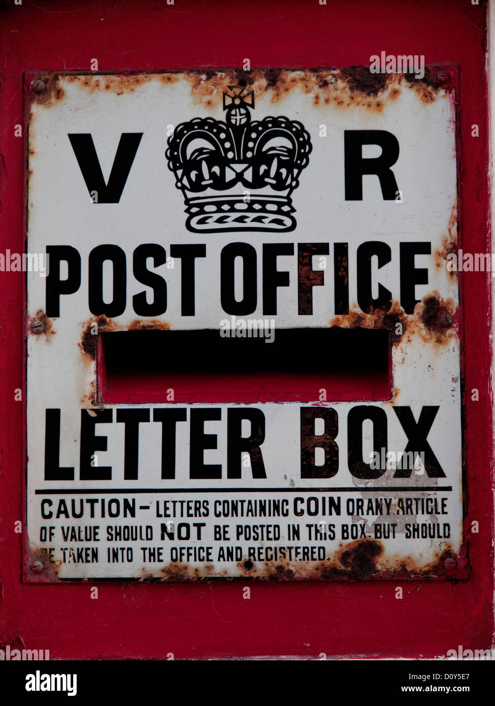 A Rusty Old Post Office Letter Box In An English Village Stock Photo