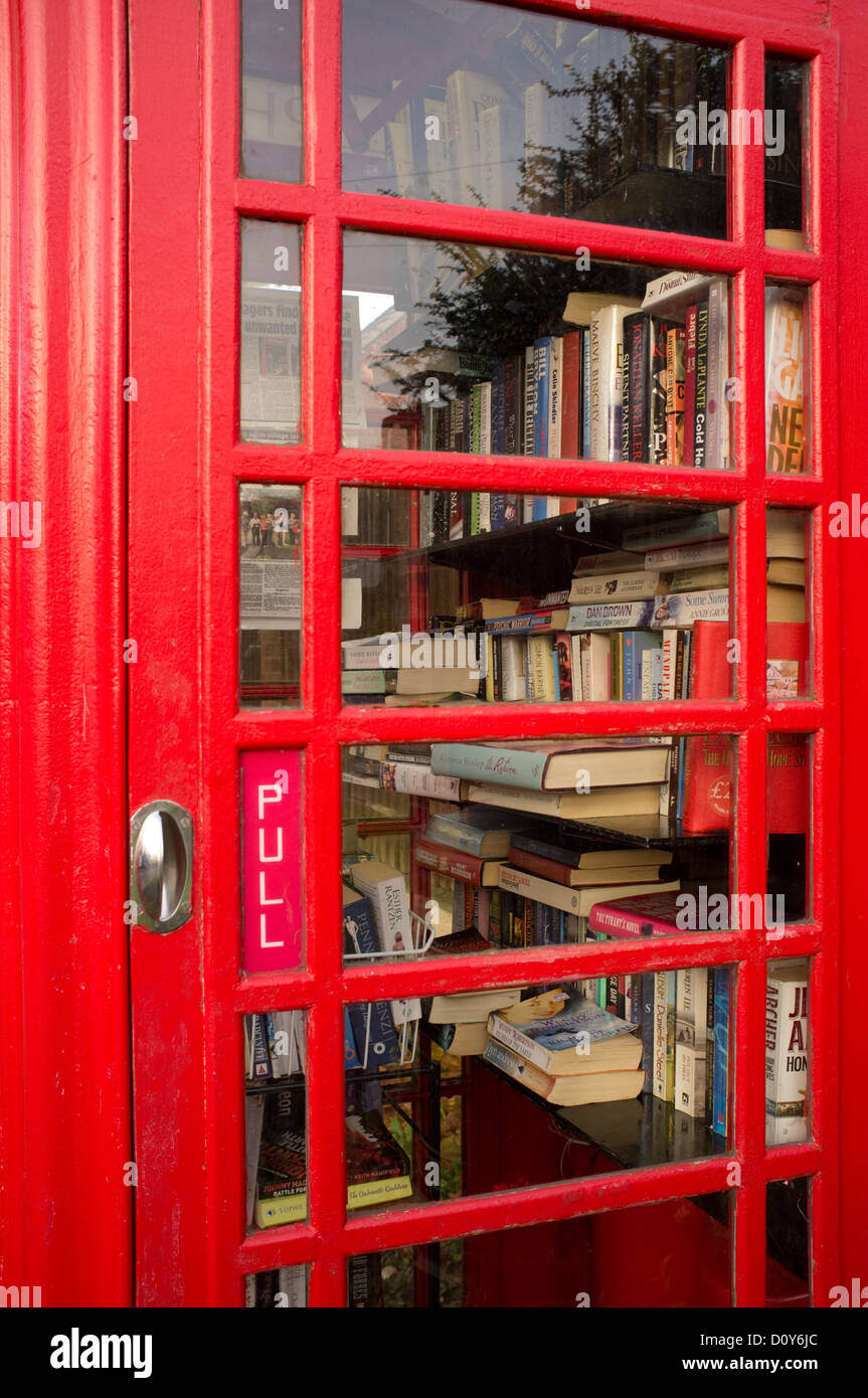 Telephone box being used for a village used book library, called a book exchange, England, UK - Stock Image