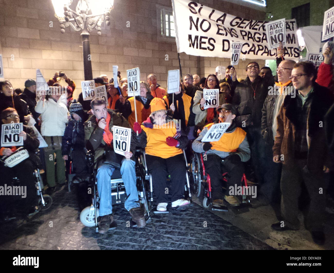 3rd December at 7.00 pm, Barcelona. Protests against cuts in the budget for people with disabilities in the Plaça - Stock Image