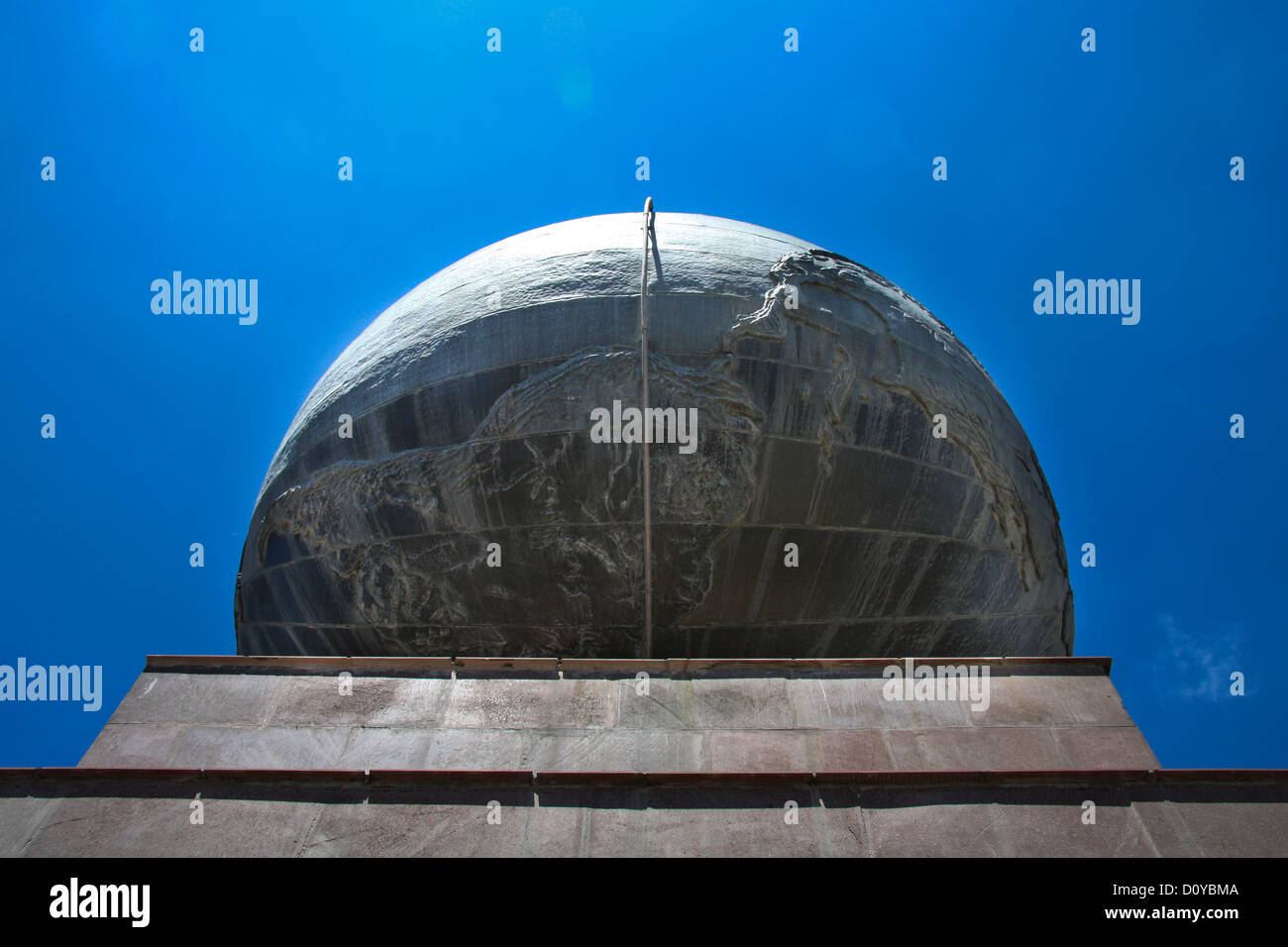 Earth globe in middle of the world in Ecuador - Stock Image