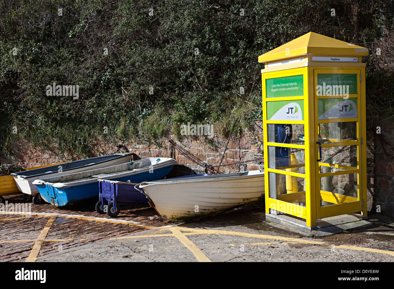 Yellow telephone kiosk, Bonne Nuit, Jersey, Channel Islands, UK - Stock Image