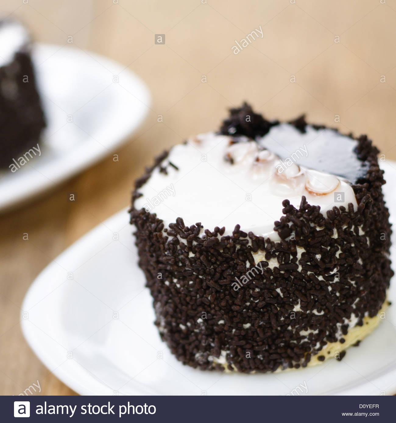 Chocolate sprinkle cake - Stock Image