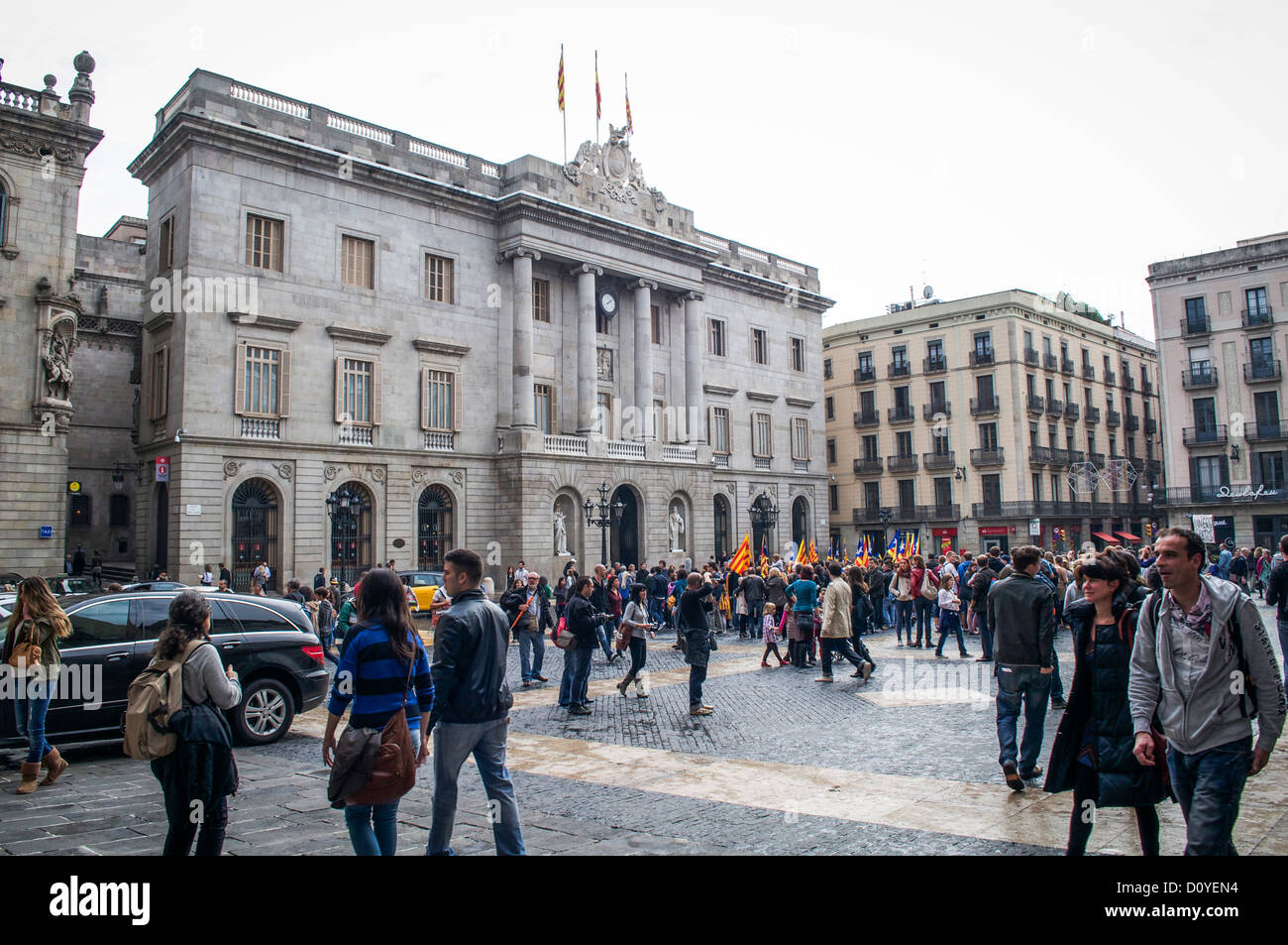 Catalonia political rally with flag carrying participants in front of a government building in Barcelona, Spain. - Stock Image