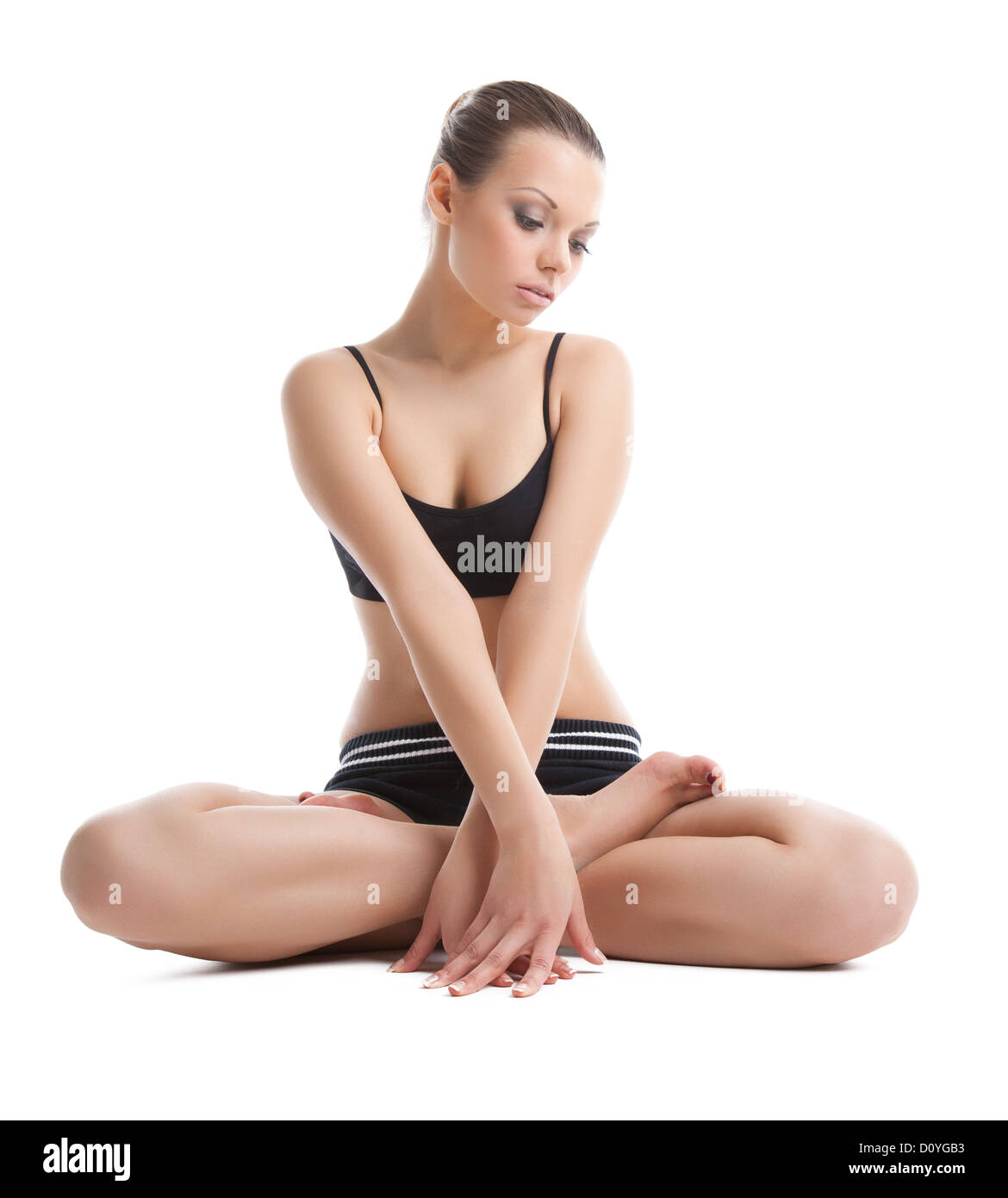 Beautiful young woman sit in lotos yoga pose - Stock Image