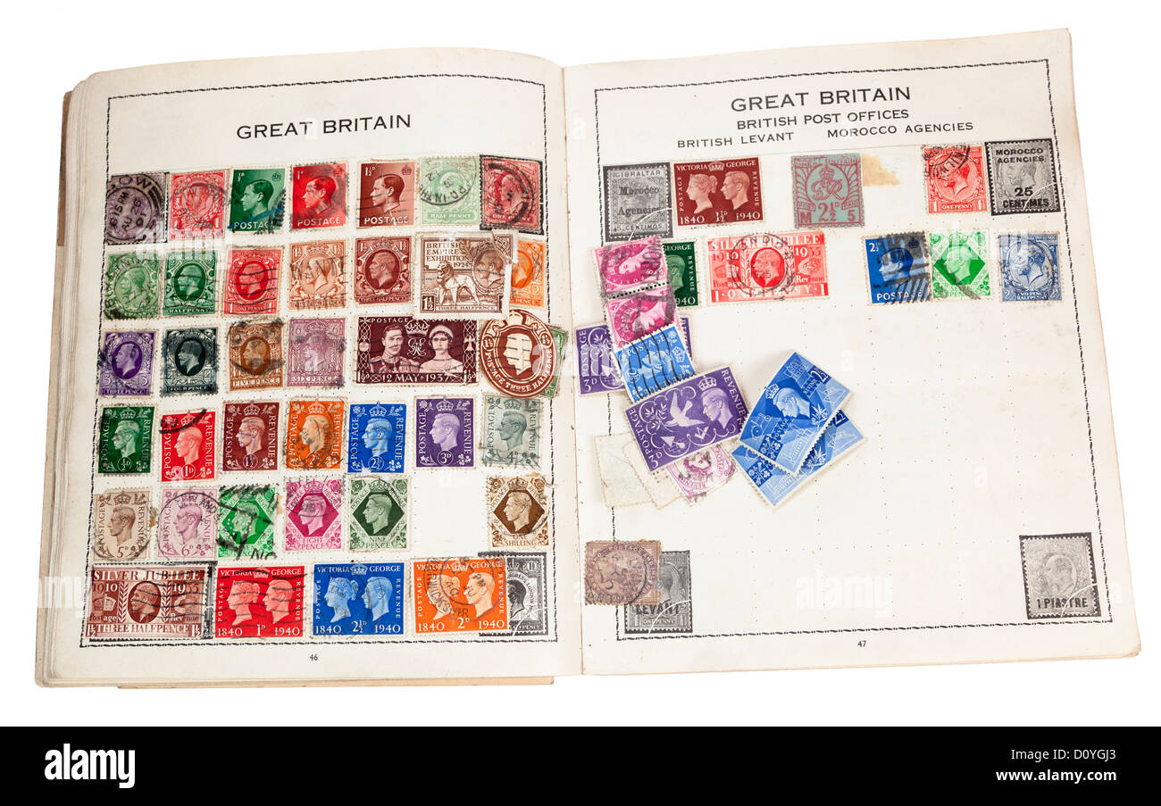 Old stamp album with British stamps, UK - Stock Image