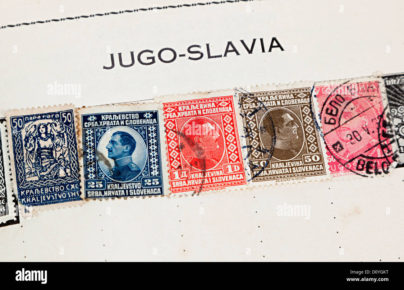 Old stamp album with country name Jugoslavia - Stock Image