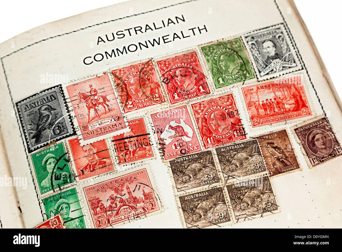 Old stamp album with Australian Commonwealth heading, UK - Stock Image