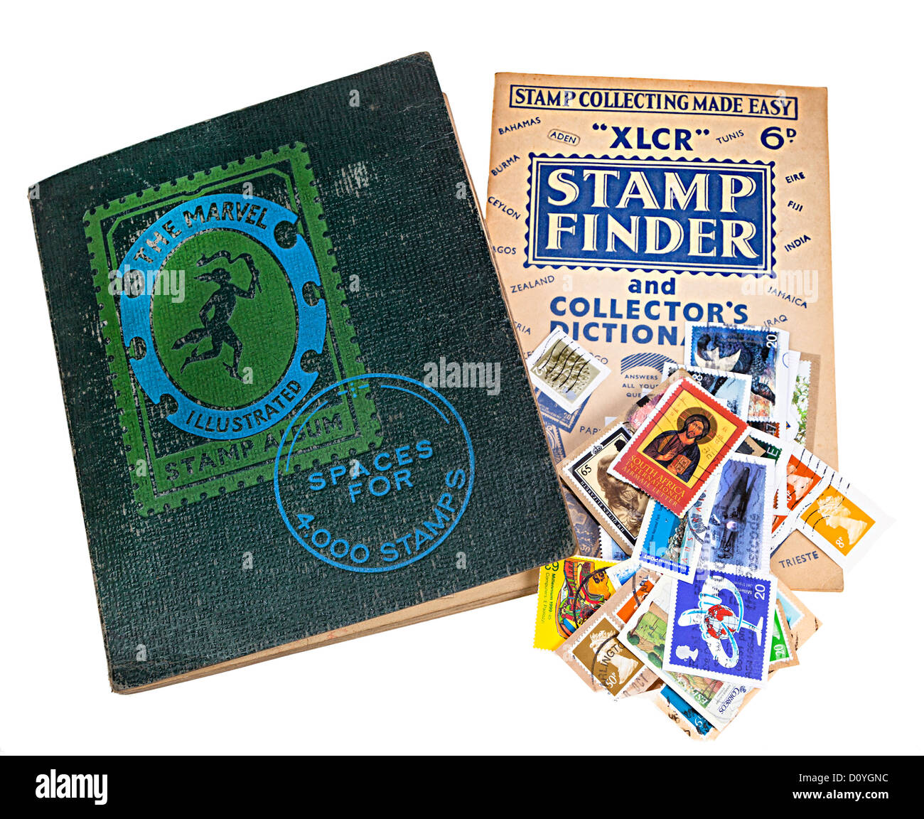 Old stamp album with stamp collecting guide and loose stamps, UK - Stock Image