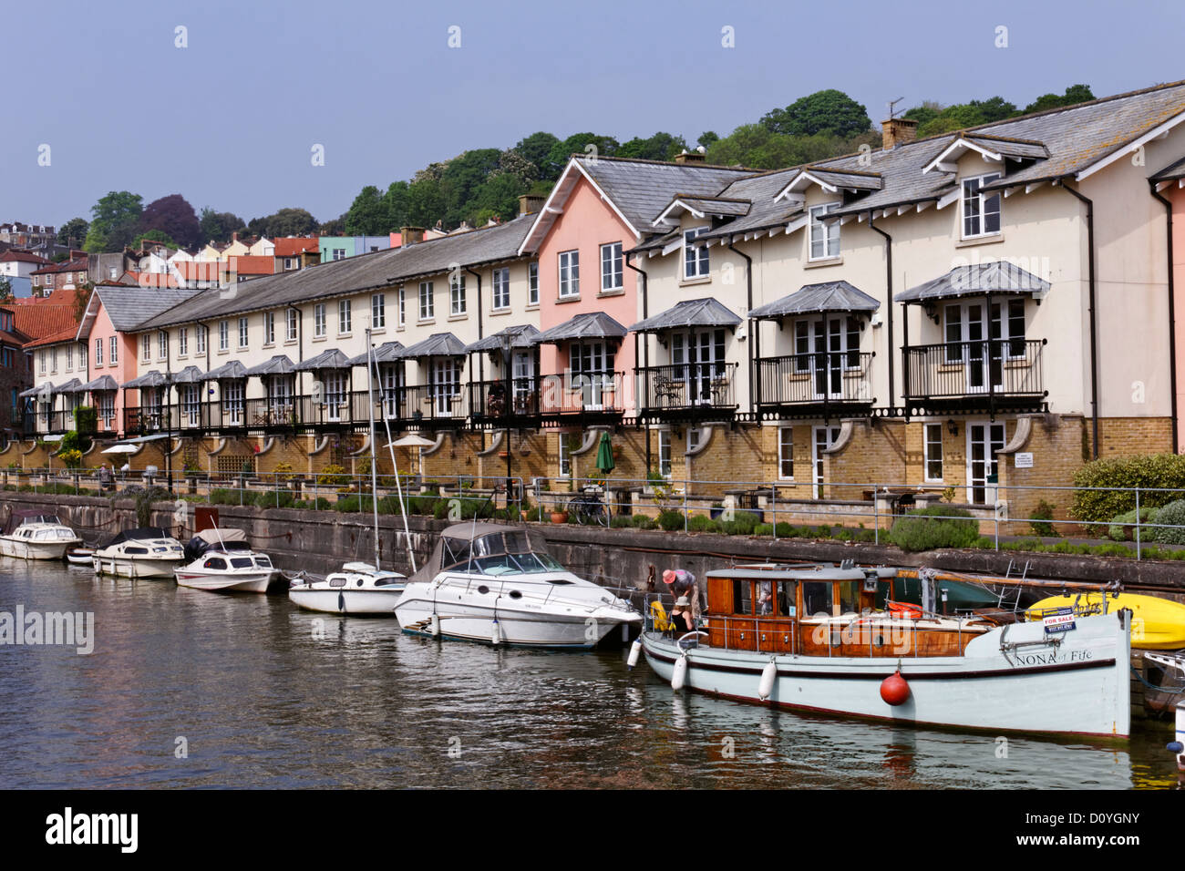 Boats and houses at Harbourside, Bristol, Somerset, England - Stock Image