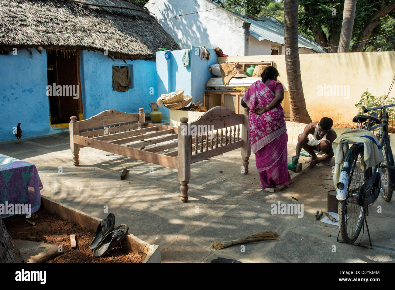 Rural indian village man making a bed outside his workshop. Andhra Pradesh India - Stock Image