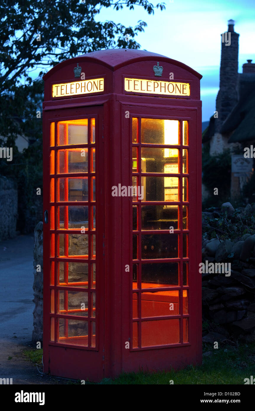 Red telephone box at night, England, UK - Stock Image