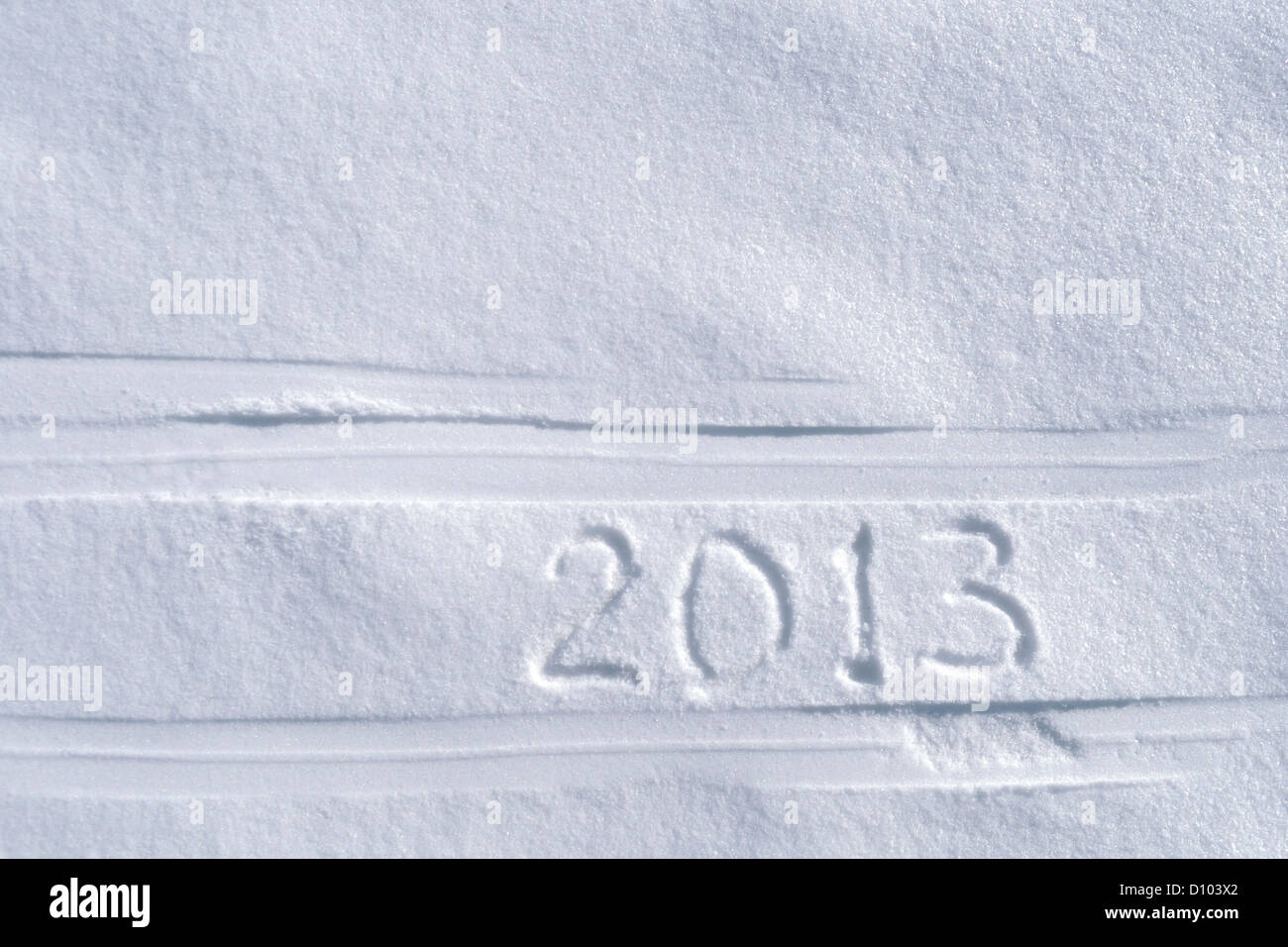 2013 text written between ski tracks - Stock Image
