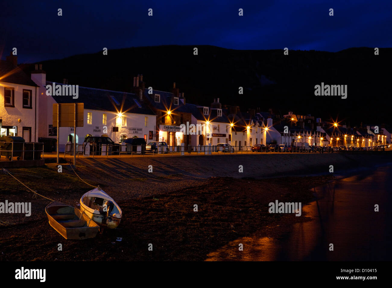 Ullapool harbour front at night. - Stock Image