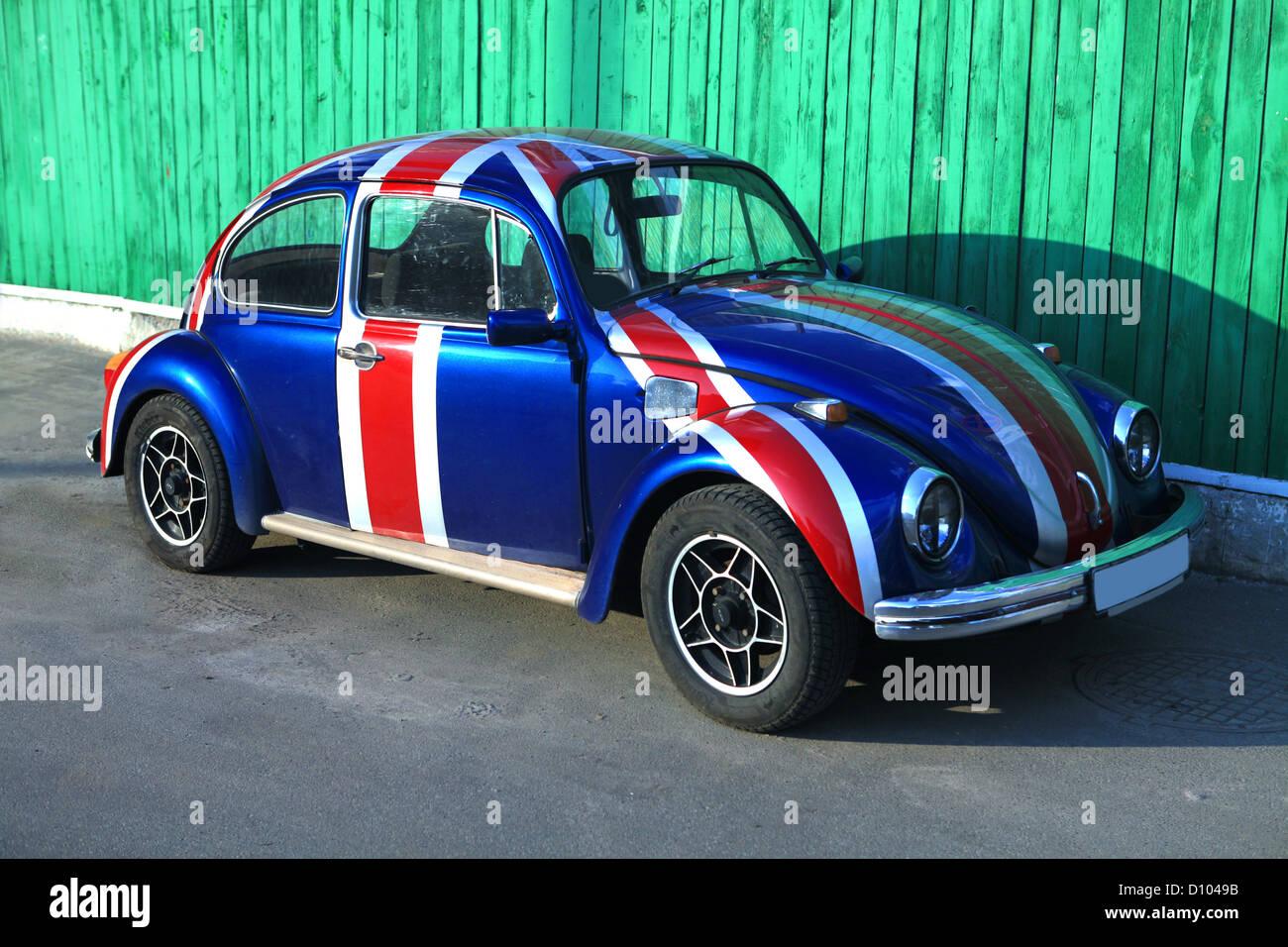 dark blue old vintage beetle car park street - Stock Image