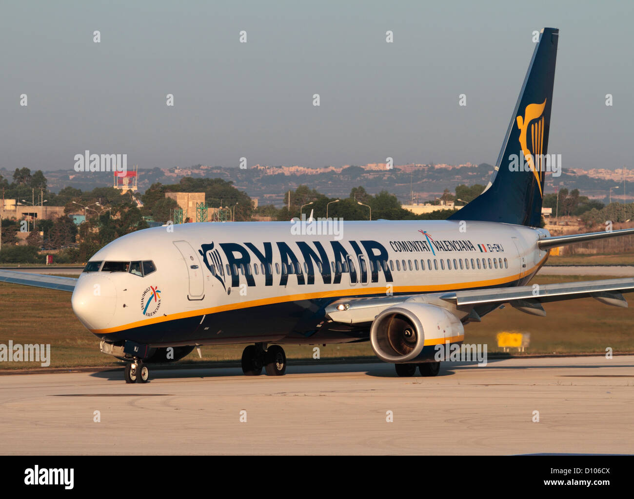 Low cost air travel. Boeing 737-800 passenger jet plane belonging to budget airline Ryanair taxiing for departure - Stock Image