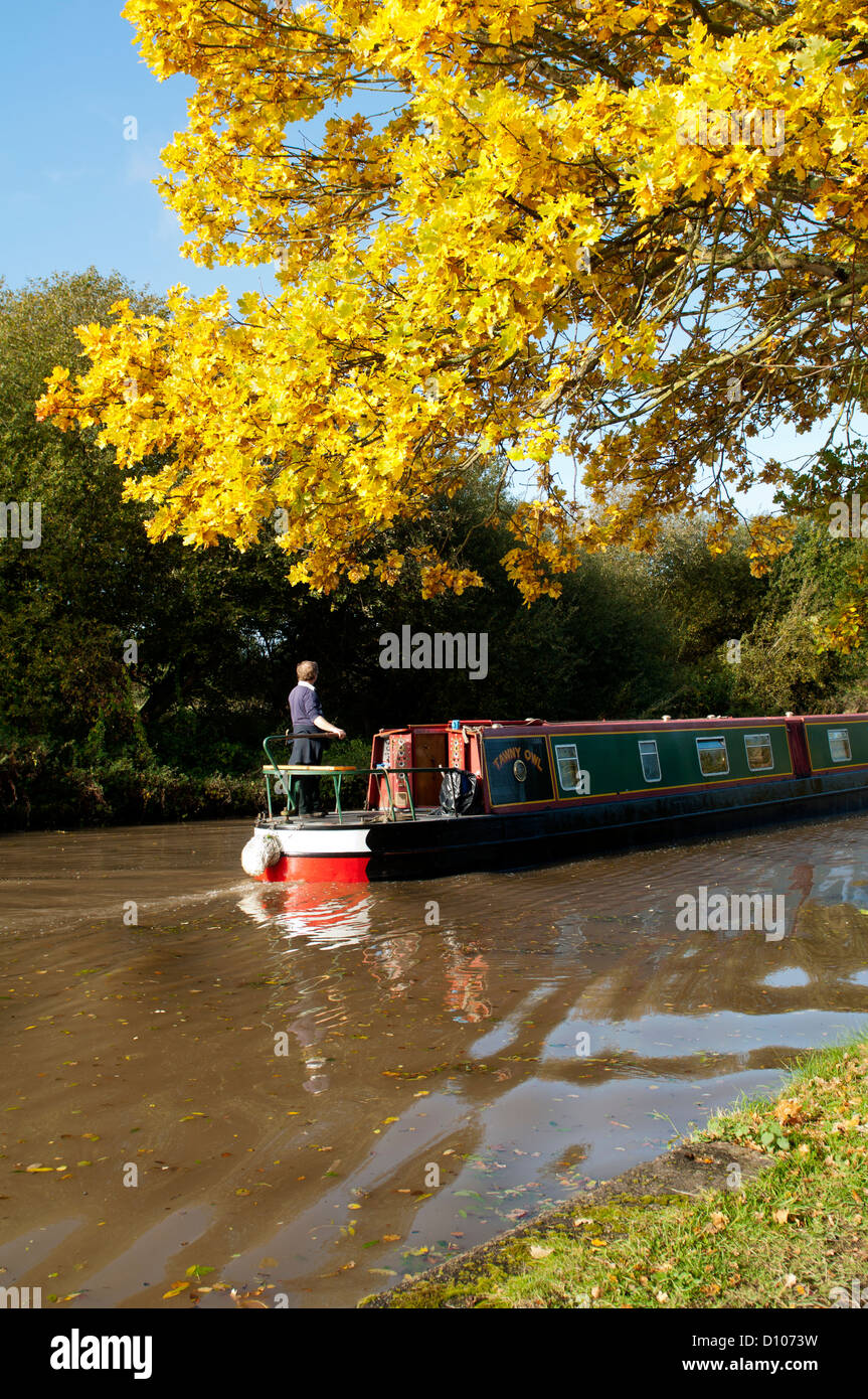 Narrowboat on the Grand Union Canal in autumn, Warwickshire, UK - Stock Image