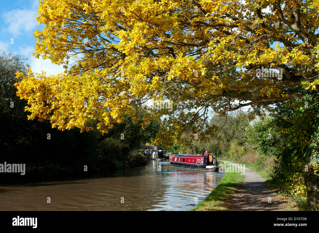 Narrowboat on the Grand Union Canal at Hatton Locks in autumn - Stock Image