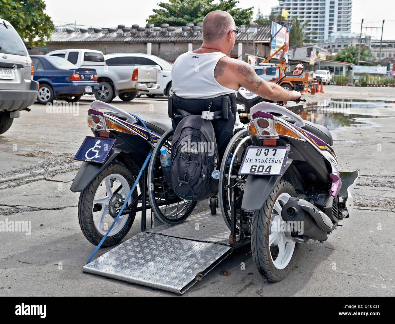 Owner modified motorcycle inventively constructed to carry invalid wheelchair and passengers with easy access ramp. - Stock Image