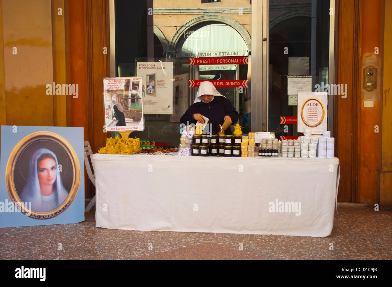 Nun selling products made in a local monastery Via dell'Indipendenza street central Bologna city Emilia-Romagna - Stock Image