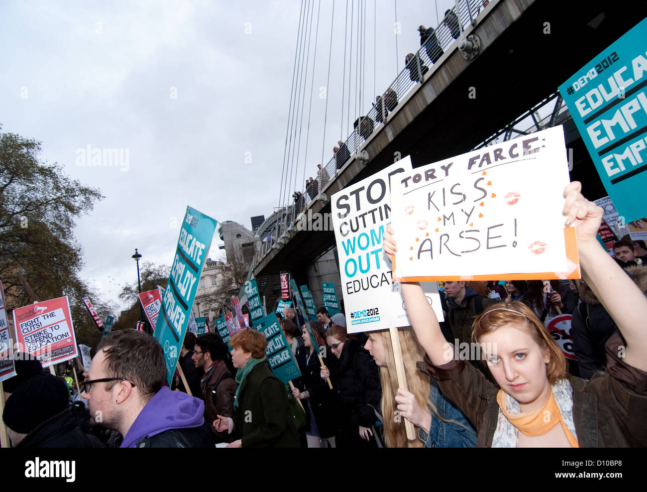 'Tory Farce' Protester with placard at the Students London Demo 2012. - Stock Image