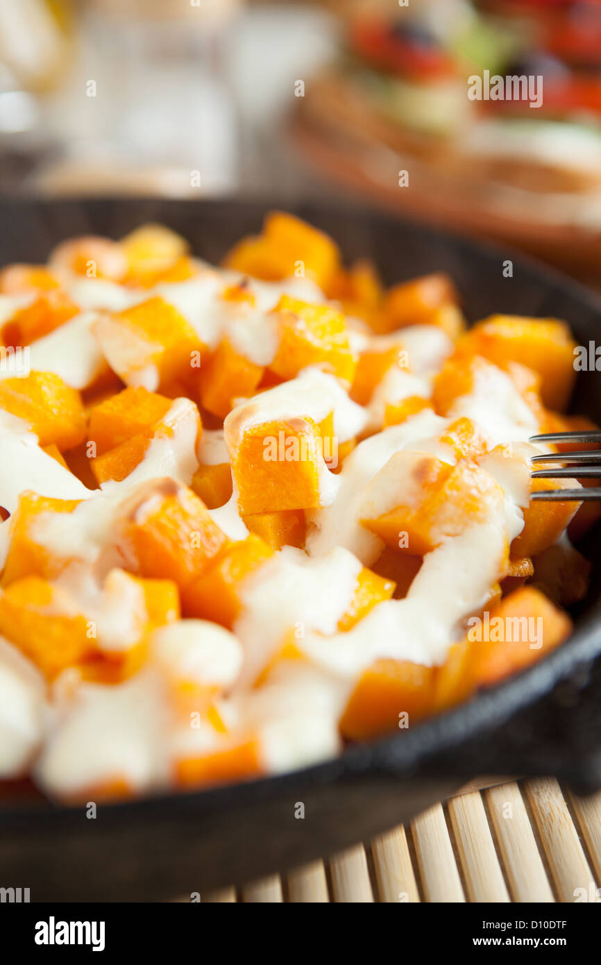 Slices of pumpkin and cream cooked in the oven, close up food Stock Photo