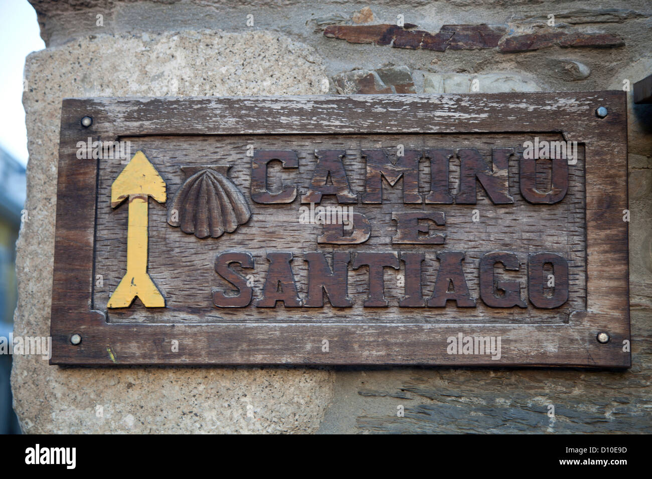 Yellow Arrow points the way on the Camino de Santiago, the pilgrimage route known as the Way of St. James, Northern - Stock Image