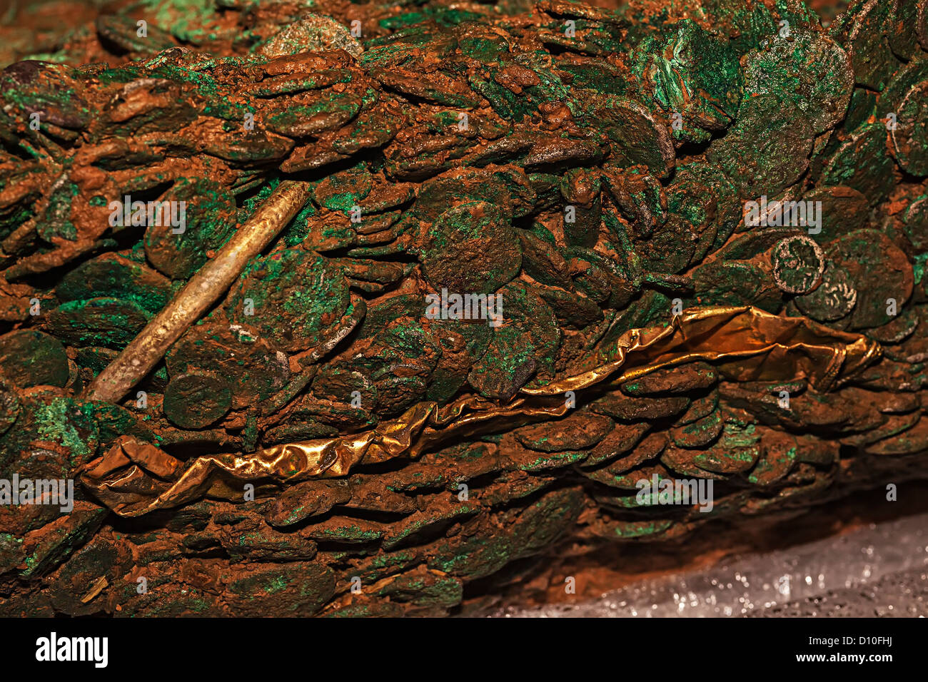 Jersey Celtic coin hoard and gold ornaments fused together over time discovered on Jersey in 2012, Channel Islands, - Stock Image