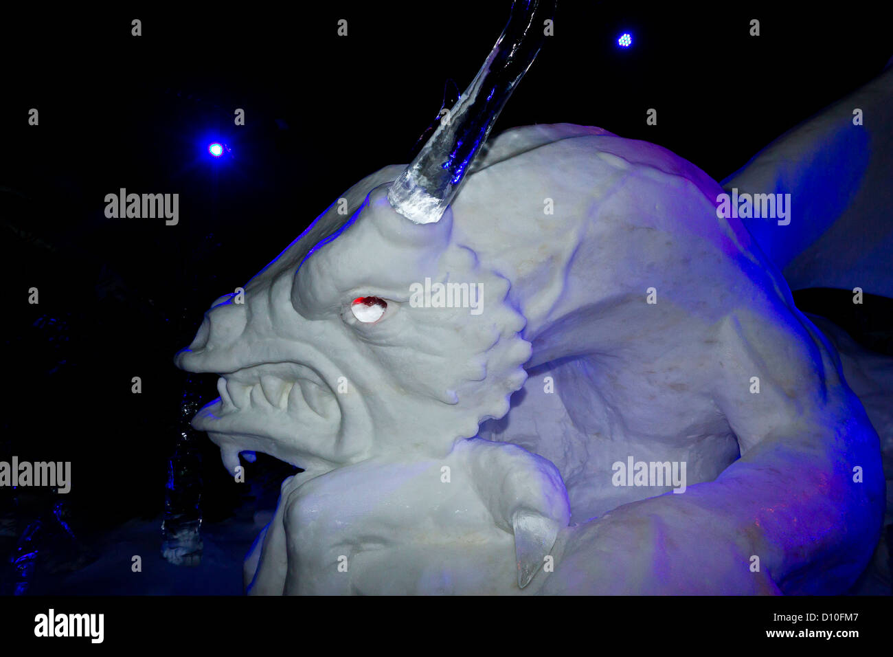 Carved Ice Sculpture Of A Dragon In The ice Kingdom At The Winter Wonderland Hyde Park London, England, UK Stock Photo