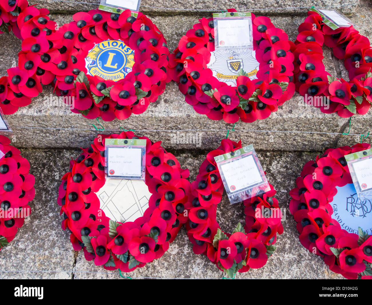 Poppy wreaths on Padstow war memorial, Cornwall. - Stock Image