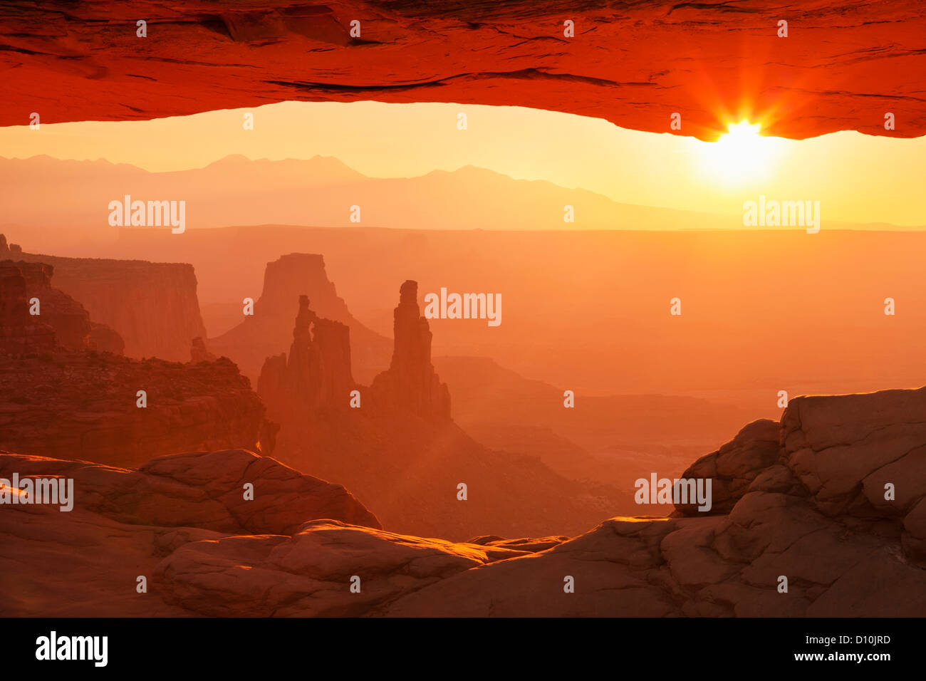 Sunrise Landscape, La Sal Mountains, Washer Woman Arch, and Mesa Arch, Island in the Sky, Canyonlands National Park, - Stock Image