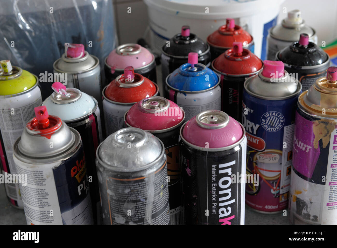 Cans of aerosol spray paint in an artists' studio - Stock Image