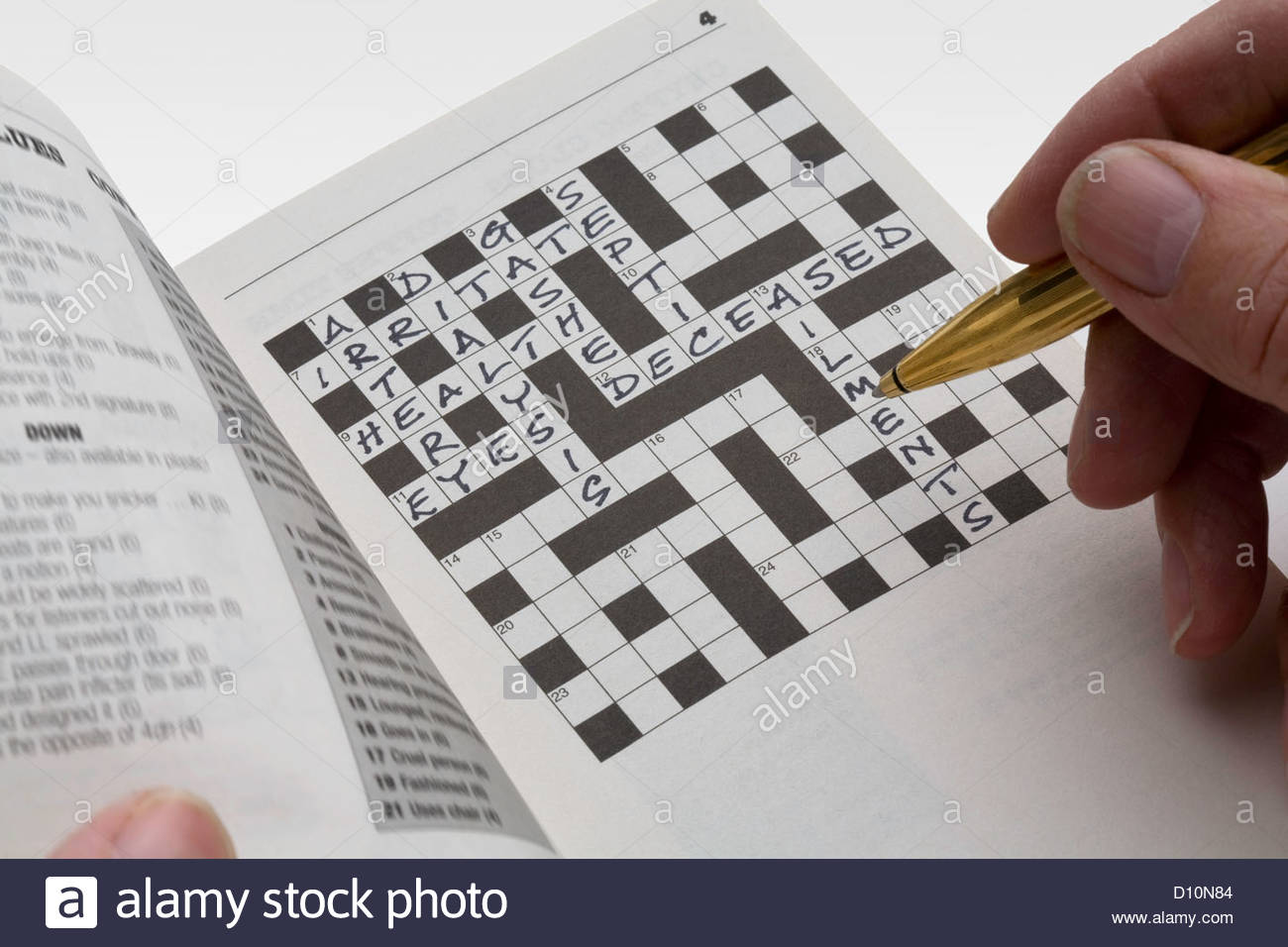 Man filling is a crossword puzzle relating to health. - Stock Image