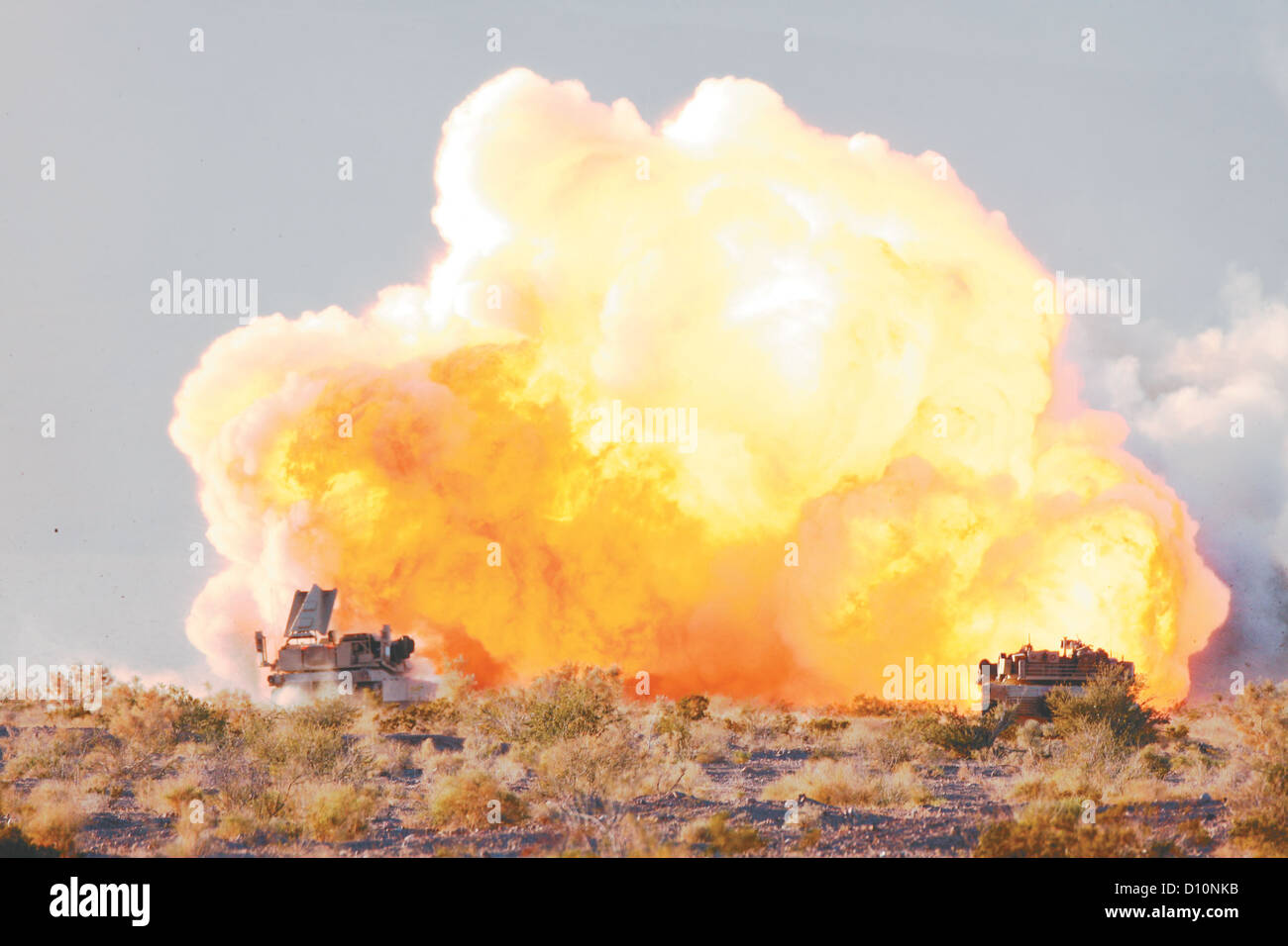 A Mine Clearing Line Charge explodes as 1st Tank Battalion tanks prepare to assault through their objective during Stock Photo