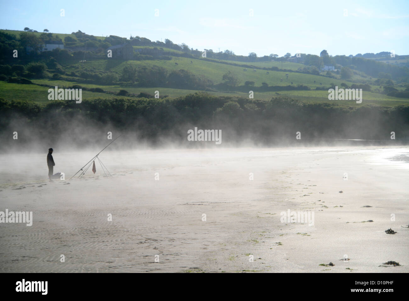 Sea mist and angler Poppit Sands St Dogmaeils Pembrokeshire Wales UK c Stock Photo