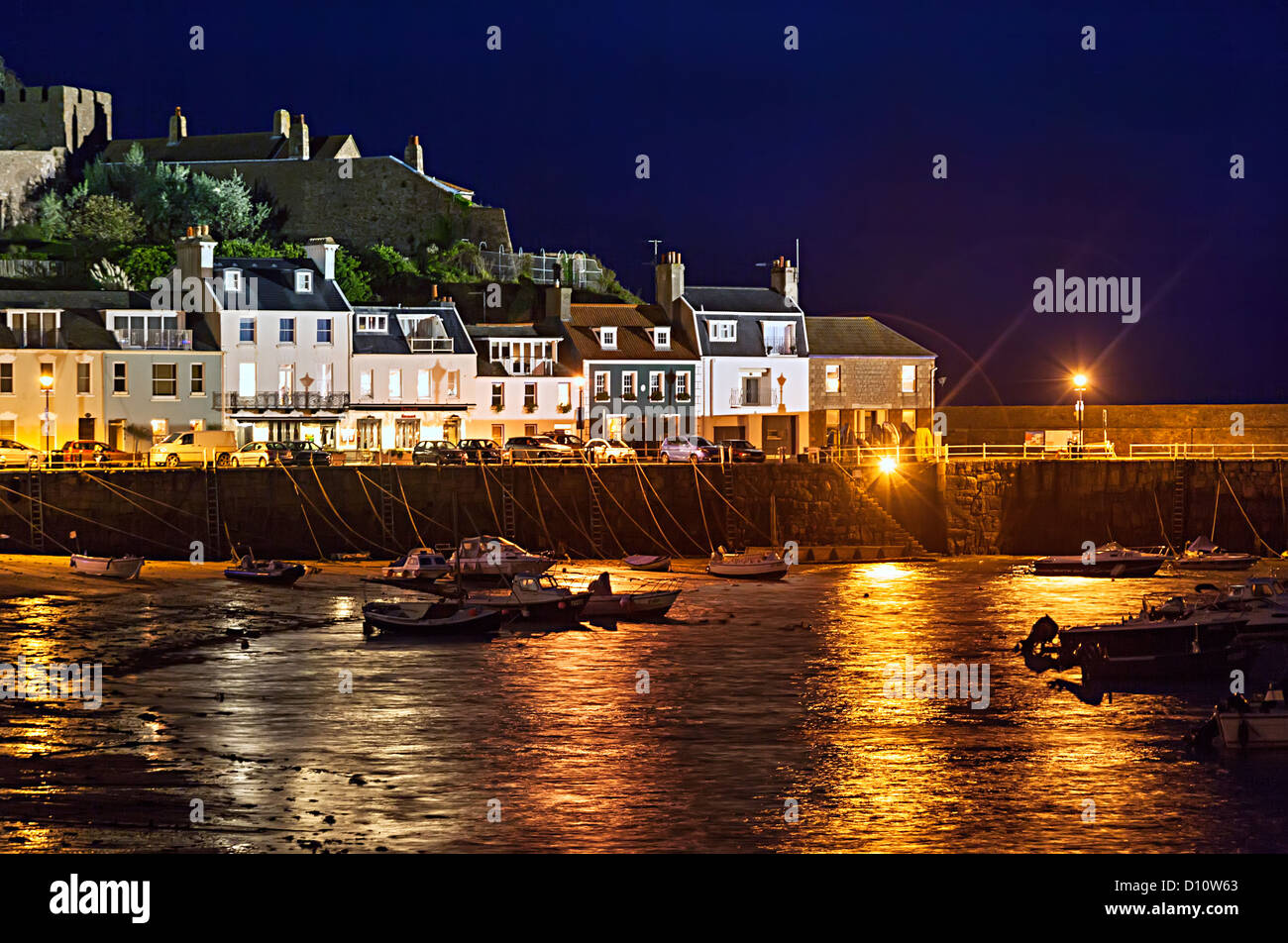 Mont Orgueil Castle and Gorey harbour at night, Jersey, Channel islands, UK - Stock Image