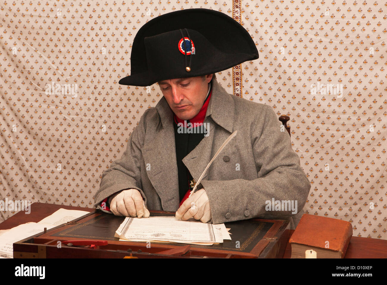 Napoleon Bonaparte signing documents inside his tent at the eve of the Battle of Jean-Auerstedt, Germany Stock Photo