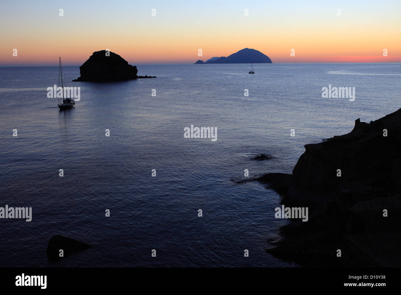Faraglione rocks and Filicudi island seen from Pollara, Salina, Aeolian islands, Sicily, Italy Stock Photo