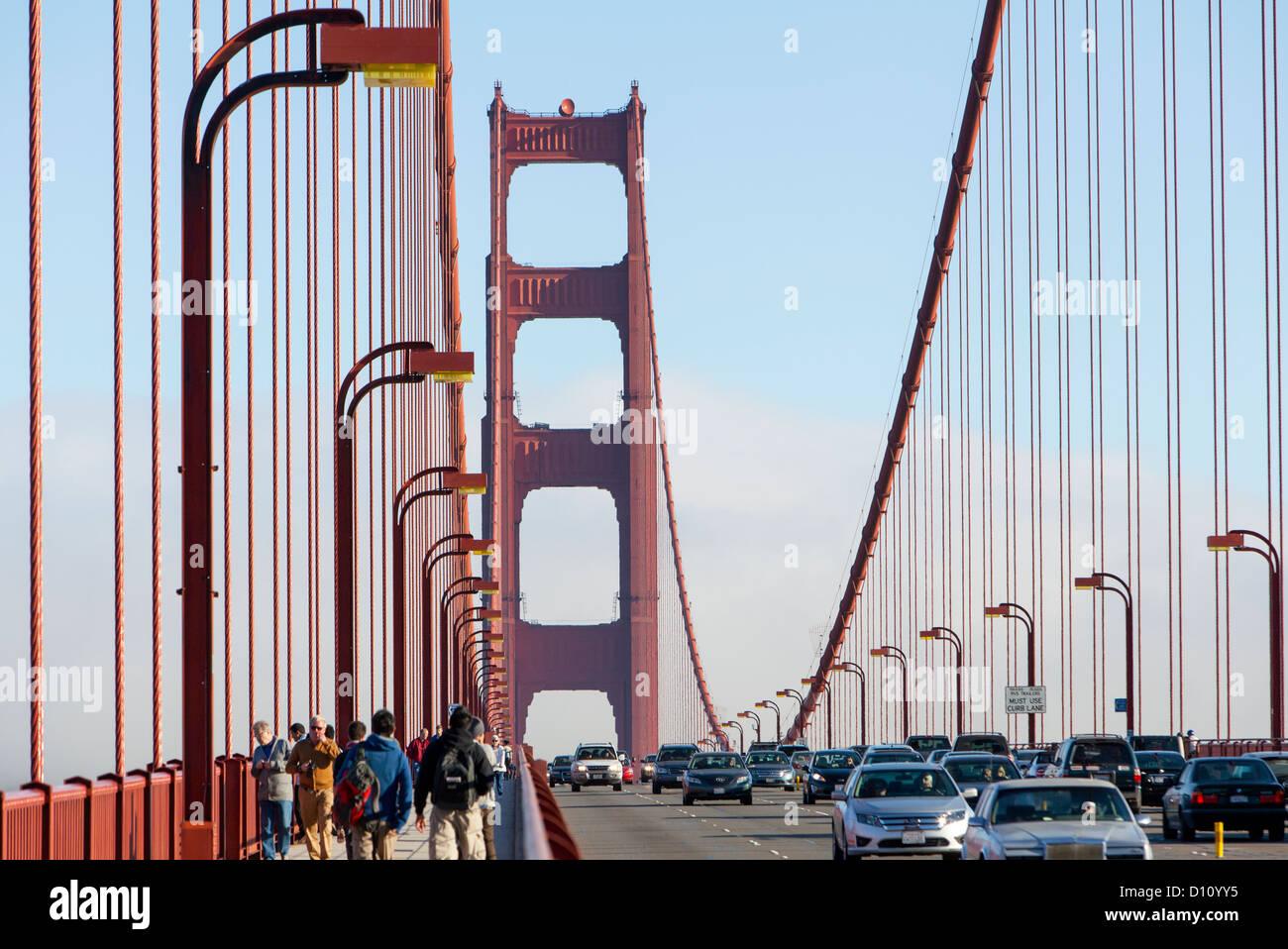 The San Francisco Golden Gate Bridge Pedestrians Walking Across The Bridge And Cars Driving Across Stock Photo Alamy