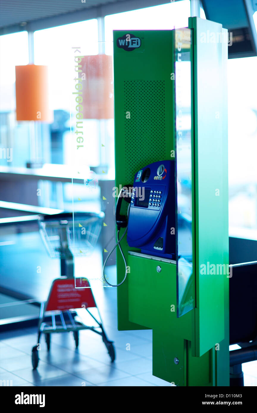 Telephone box in an International Airport - Stock Image